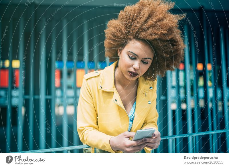 Mixed race woman sitting and on the mobile phone Woman Smiling Portrait photograph Black Cellphone Mobile Telephone PDA Technology Communication Internet