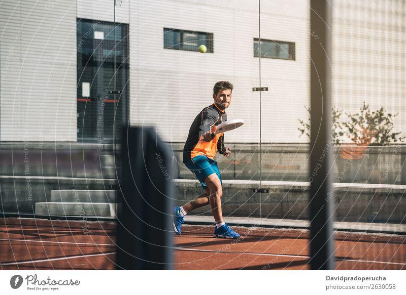 Man playing padel Glass Court building Joy Leisure and hobbies Exterior shot Shot Match