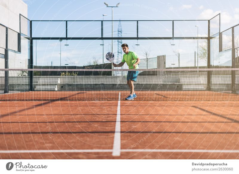Sportsman playing padel game Glass Court building Joy Leisure and hobbies Exterior shot Match paddel tournament Looking away padel tennis Playing Tennis