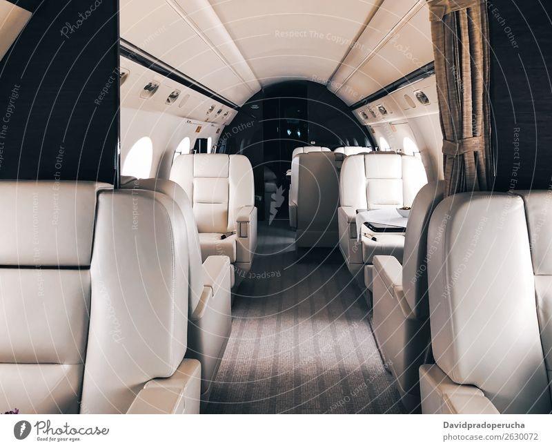 Interior of a private luxury jet Aircraft Aviation Airplane Airport Business business class Close-up Comfortable comfy Copy Space Empty Exclusive Expensive