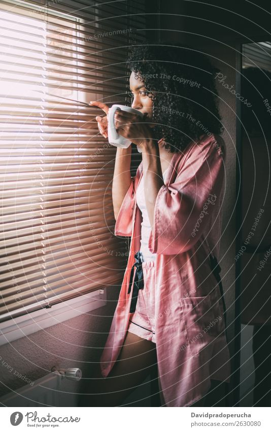 pretty black woman standing at the window with cup of coffee Woman Coffee Tea Window backlit Bedroom Afro African-American To enjoy Black Drinking Cup