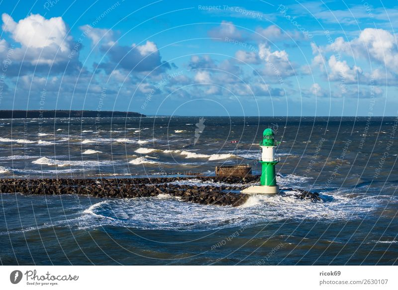 Mole at the Baltic Sea coast in Warnemünde Relaxation Vacation & Travel Tourism Ocean Waves Environment Water Clouds Climate Weather Gale Coast Lighthouse