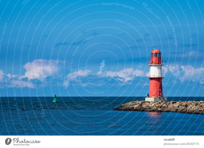 Mole at the Baltic Sea coast in Warnemünde Vacation & Travel Ocean Water Clouds Coast Lighthouse Architecture Tourist Attraction Navigation Maritime Blue Green