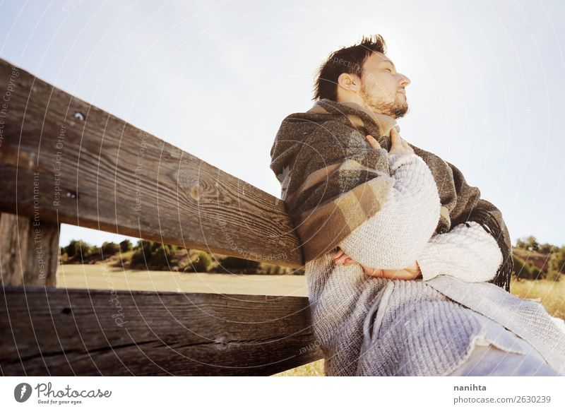 Young man enjoying a sunny winter day Human being Youth (Young adults) Man Relaxation Loneliness Calm Winter Healthy Lifestyle Adults Wood Autumn Natural Style