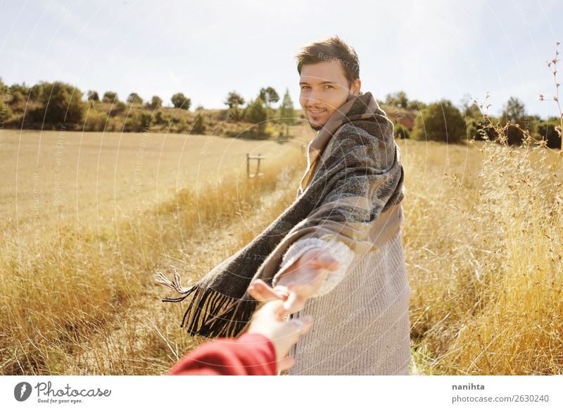 Man holding his couple's hand in a field Human being Nature Youth (Young adults) Summer Young man Joy Lifestyle Adults Autumn Environment Love