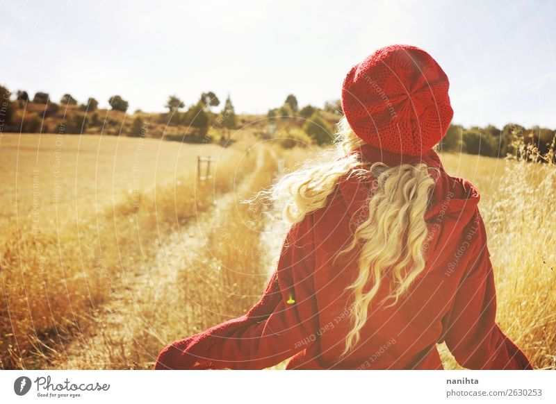 Back view of a young blonde woman in nature Woman Human being Nature Youth (Young adults) Young woman Red Sun Relaxation Joy 18 - 30 years Healthy Lifestyle