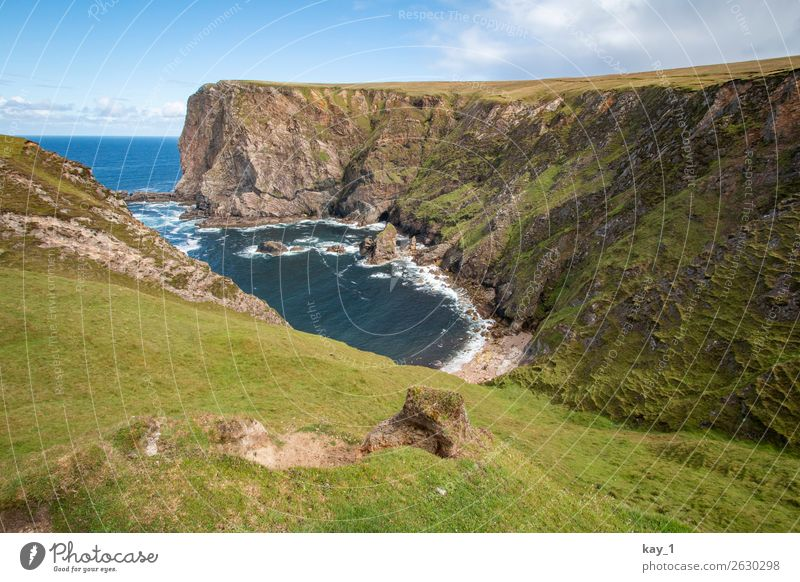 Bay of the Atlantic Ocean, surrounded by cliffs, grass Clouds Day Landscape Water Summer Loneliness Blue coast Beautiful weather Tourism Adventure