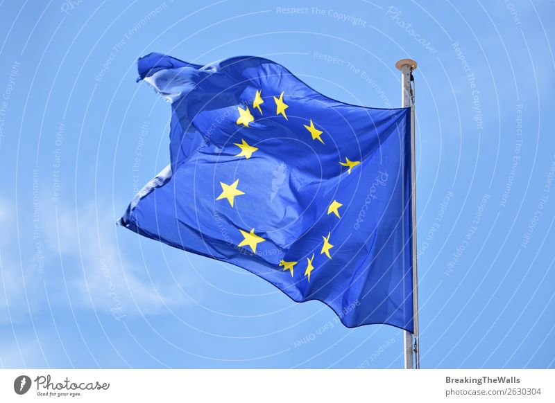 Close up flag of EU waving in wind over blue sky Sky Clouds Wind Sign Signs and labeling Flag Flying Blue Attachment European Vantage point Flap Blow national