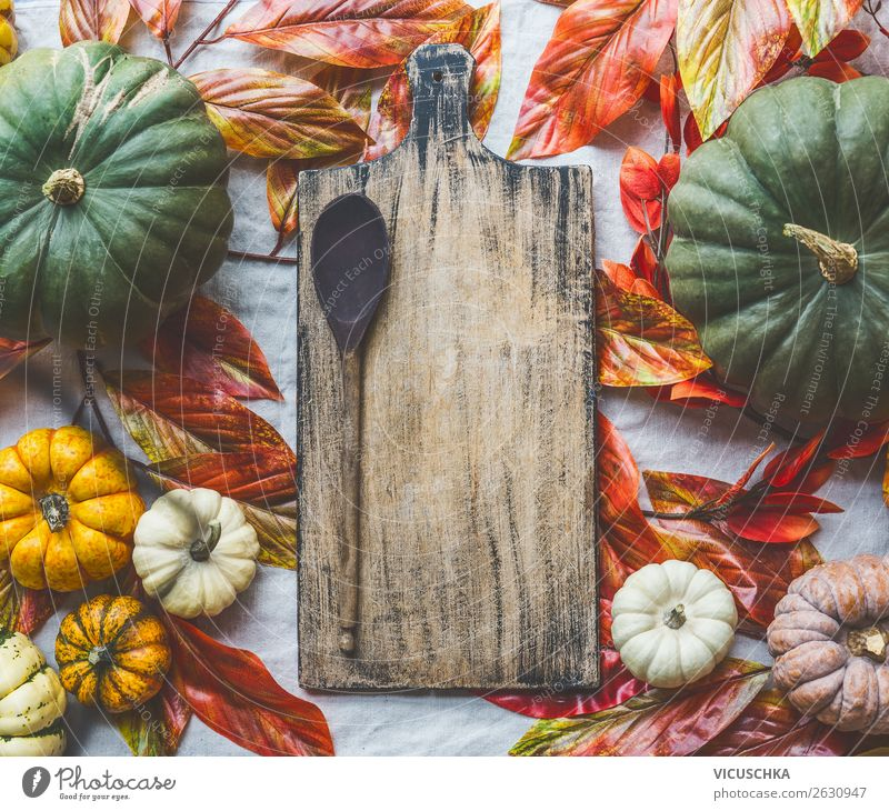 Background with pumpkins, chopping board and cooking spoon Food Vegetable Nutrition Organic produce Vegetarian diet Style Design Healthy Eating