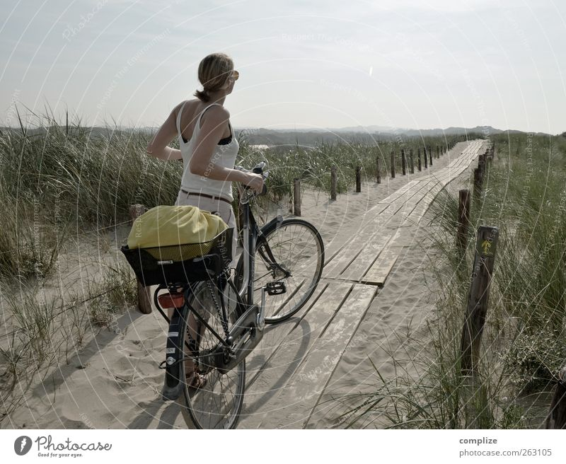 de duinen Vacation & Travel Tourism Trip Far-off places Cycling tour Summer Young woman Youth (Young adults) Woman Adults 1 Human being Coast North Sea Bicycle