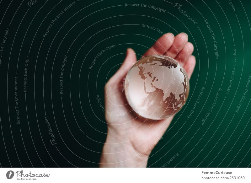 Hand with transparent globe in front of green background Nature Horizon Globe Earth Transparent To hold on Green Dark green Asia Europe Africa Saudi Arabia