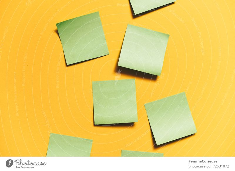 Notes on a neutral yellow background Stationery Paper Piece of paper Creativity Brainstorming Yellow Green Empty pasted self-adhesive Colour photo Studio shot