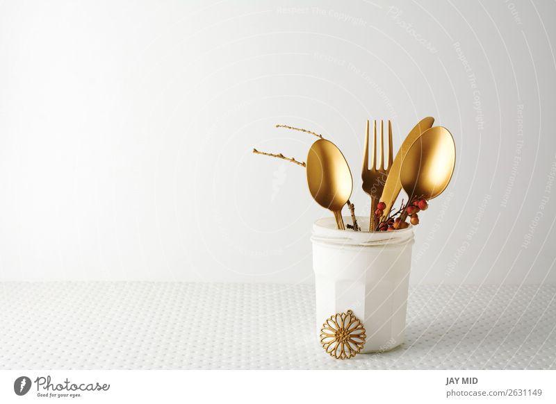 Festive golden cutlery knife and fork spoon in a white bottle Lunch Dinner Bottle Cutlery Fork Spoon Elegant Design Decoration Table Kitchen Restaurant