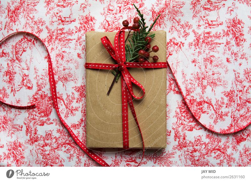 Gift box, wrapped in recycled paper and red bow Roll Shopping Elegant Feasts & Celebrations Valentine's Day Mother's Day Easter Thanksgiving Christmas & Advent