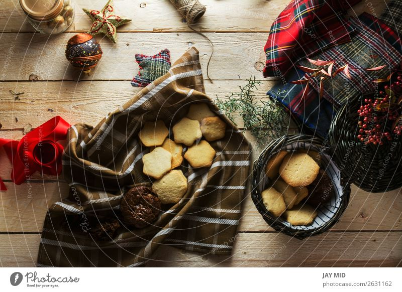 Woman keeping Christmas cookies, Photographed from above Food Cake Dessert Style Beautiful Decoration Table Christmas & Advent Adults Hand Package Wood Above