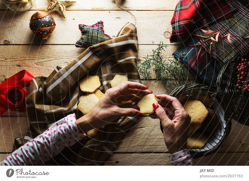 Woman keeping Christmas cookies, Photographed from above Dessert Style Beautiful Decoration Table Christmas & Advent Human being Feminine Adults Hand 1 Package
