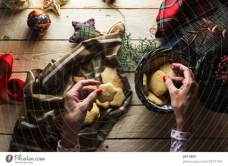 Woman keeping Christmas cookies, Photographed from above Human being Christmas & Advent Beautiful Red Hand Adults Wood Feminine Style Brown Above Decoration