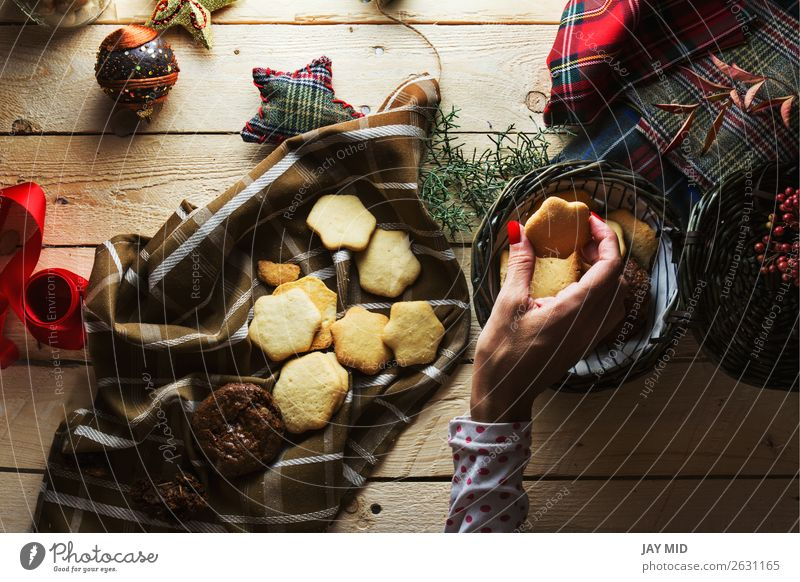 Woman keeping Christmas cookies, Photographed from above Dessert Style Beautiful Decoration Table Christmas & Advent Adults Hand Fingers 1 Human being Package