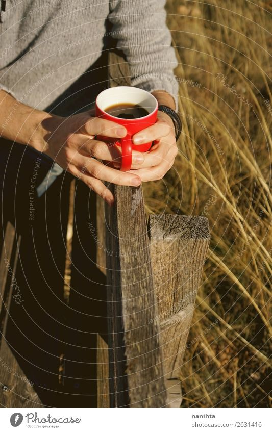 Man holding a cup of coffee in a wooden bench Breakfast Beverage Drinking Hot drink Hot Chocolate Coffee Tea Cup Lifestyle Healthy Healthy Eating Wellness