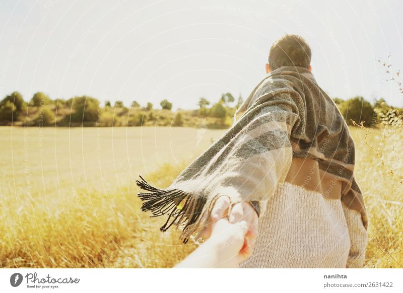 Man holding the hand of his couple in a field Human being Nature Summer Far-off places Healthy Lifestyle Adults Autumn Yellow Environment Love Natural