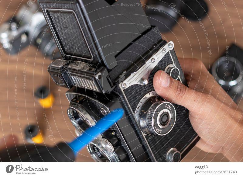 Performing cleaning of vintage photo camera film Camera Tool Technology Eyes Old Retro Black Antique Assembly background brush camera cleaning