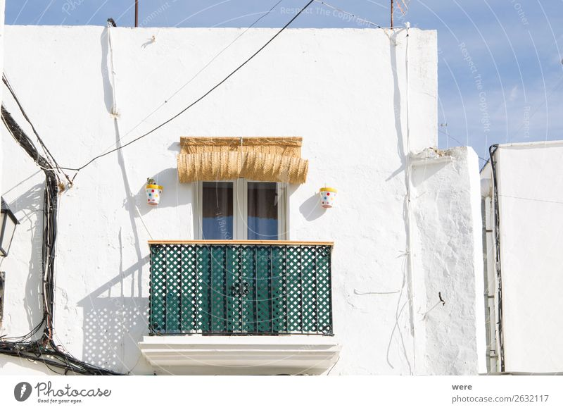 Facades of spanish houses Summer Flat (apartment) High-rise Old Uniqueness Andalusia balcony Green white striped spain blind Blue sky building copy space