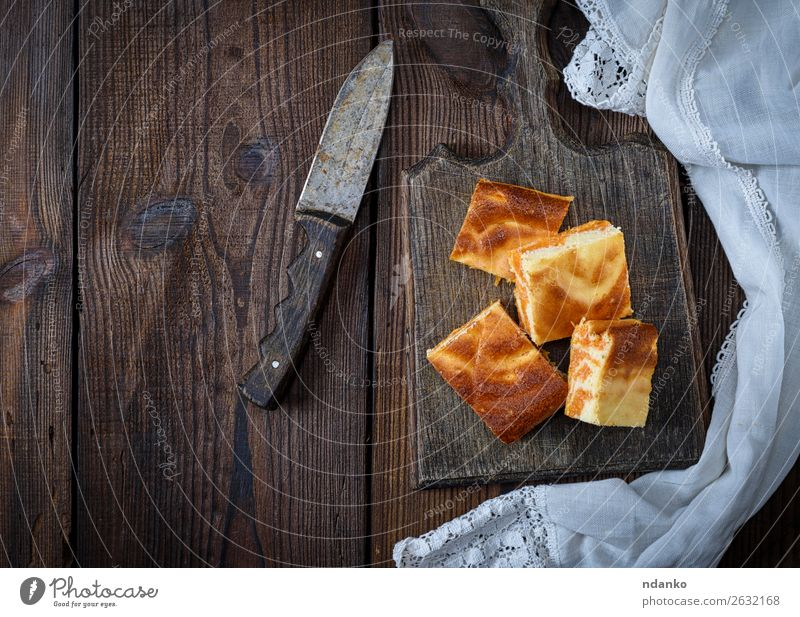 square pieces of cheesecake with pumpkin Cheese Dessert Nutrition Eating Breakfast Knives Table Autumn Fresh Delicious Brown Tradition background Baking cream