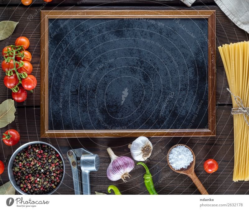 empty black frame and ingredients for cooking pasta Vegetable Dough Baked goods Herbs and spices Italian Food Spoon Blackboard Wood Line Fresh Large Long Above