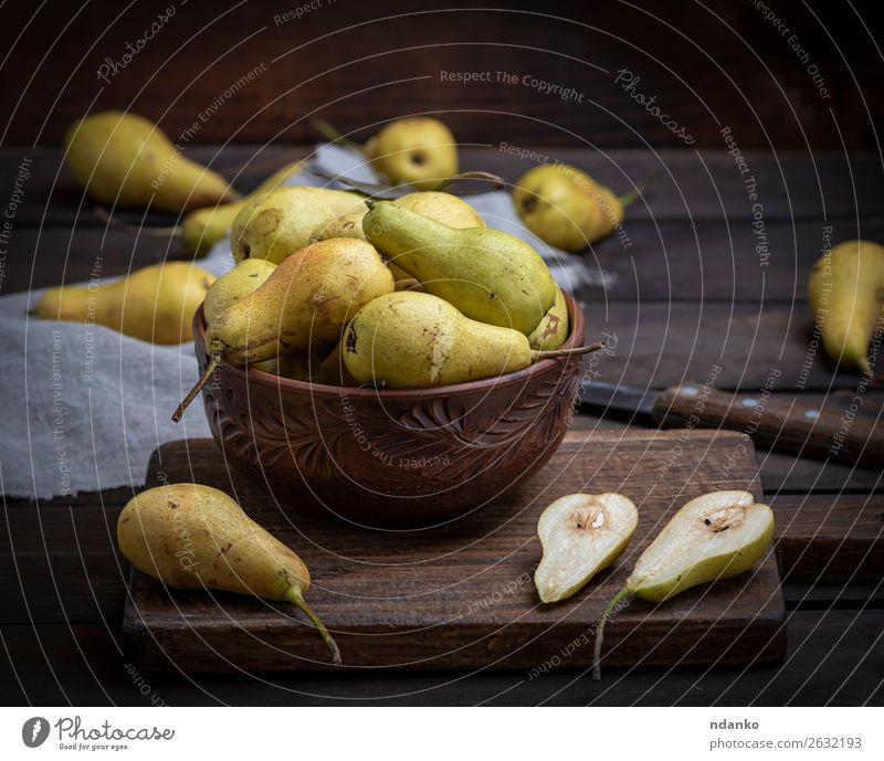 ripe green pears in a brown clay bowl on a table Fruit Nutrition Vegetarian diet Diet Bowl Table Group Nature Wood Old Eating Fresh Delicious Natural Above