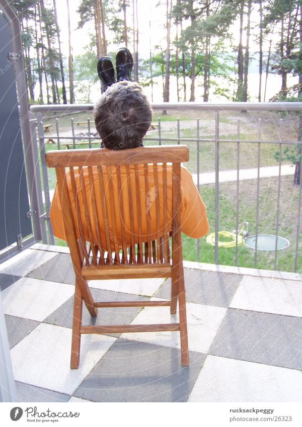 post-wedding rest phase Calm Break Relaxation Balcony Terrace Square Wooden chair Vantage point Footwear Man Checkered