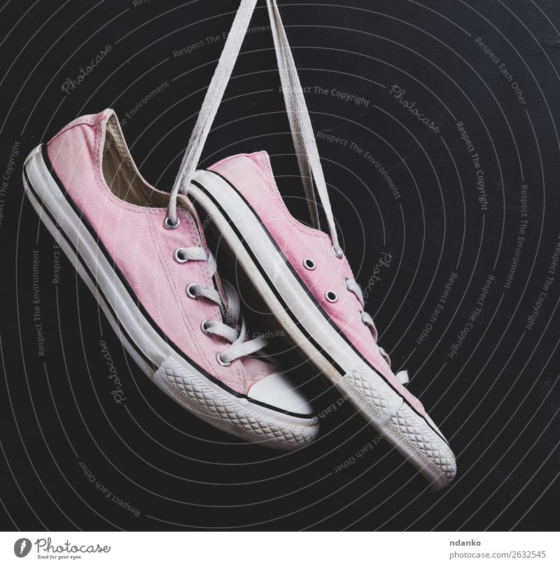 pair of textile pink sneakers Lifestyle Style Design Sports Jogging Fashion Clothing Footwear Sneakers Wood Rust Old Fitness Hang Dirty Hip & trendy Modern