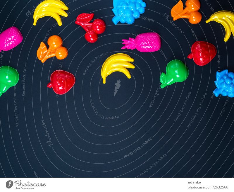 black background with childrens colorful toys Child Blue Colour Green Red Joy Black Yellow Playing Fruit Pink Above Design Bright Decoration Creativity