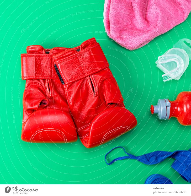 red leather boxing gloves, a plastic water bottle Bottle Lifestyle Fitness Sports Track and Field Leather Gloves Above Blue Green Pink Red Protection Colour