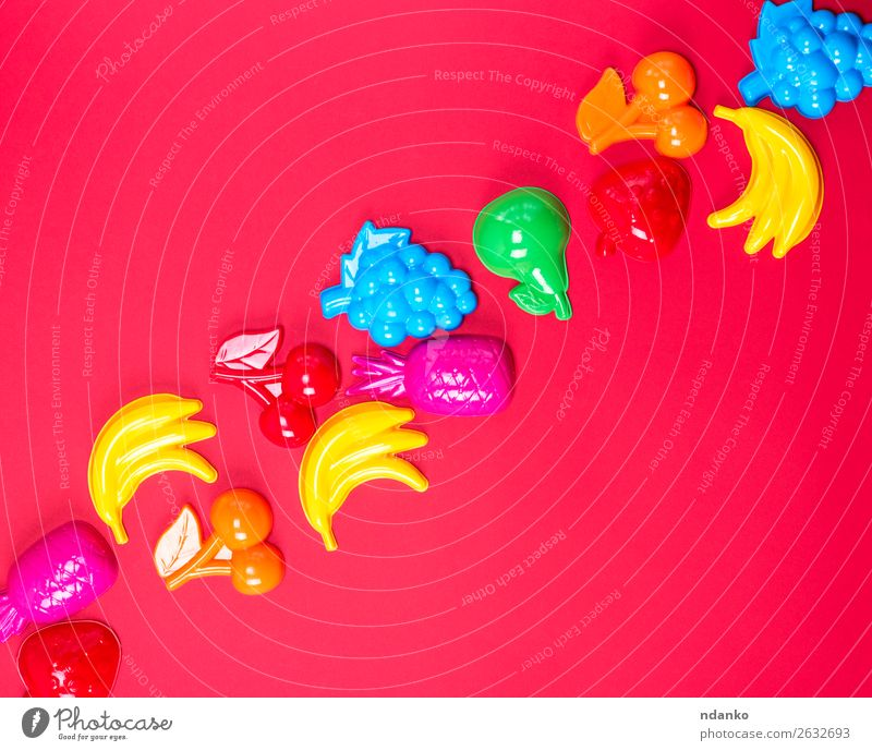 red background with childrens plastic toys Child Blue Colour Green Red Joy Yellow Playing Pink Fruit Above Bright Creativity Cute Plastic Apple