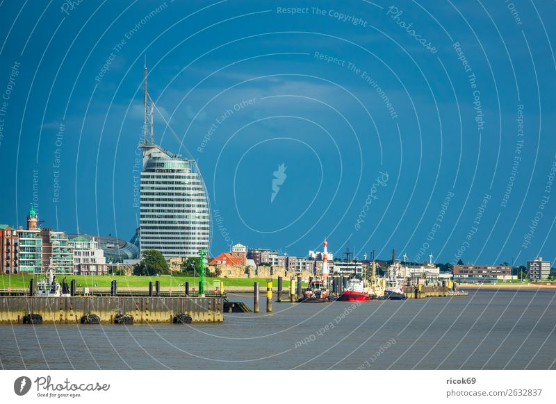 View of the city of Bremerhaven Relaxation Vacation & Travel Tourism House (Residential Structure) Clouds Coast North Sea Town Harbour Lighthouse Building