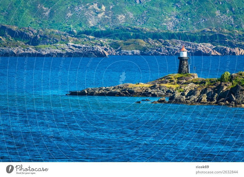 Coast with lighthouse on the Lofoten in Norway Relaxation Vacation & Travel Tourism Ocean Mountain Nature Landscape Water Grass Rock Lighthouse Blue Green Idyll