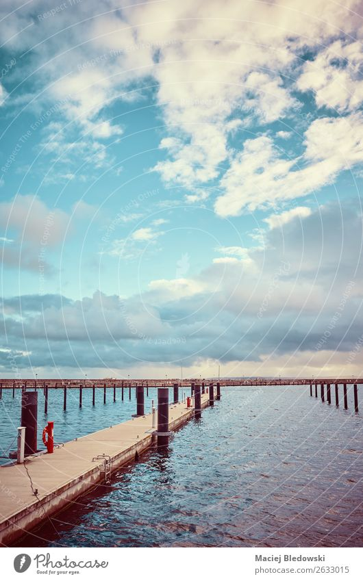 Color toned picture of an empty marina. Vacation & Travel Trip Far-off places Freedom Expedition Ocean Island Landscape Sky Clouds Horizon Coast Baltic Sea