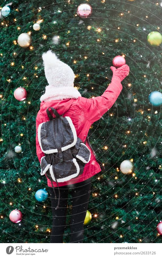 Young girl standing at front of big Christmas tree Human being Youth (Young adults) Christmas & Advent Young woman Green Tree Joy Winter Lifestyle Snow