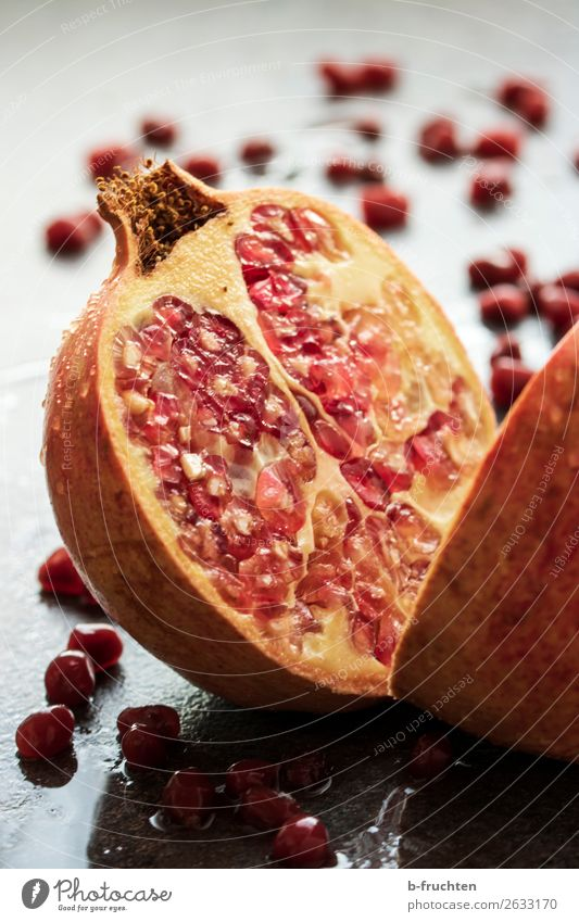 pomegranate cut open Food Fruit Organic produce Vegetarian diet Diet Healthy Eating To enjoy Fresh Round Red Belief Religion and faith Kernels & Pits & Stones