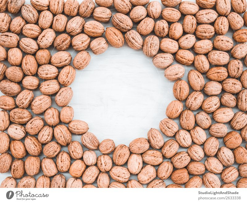 Walnuts on white wooden background with copy space Colour White Eating Wood Natural Copy Space Brown Nutrition Fresh Table Kitchen Cooking Vegetarian diet Diet