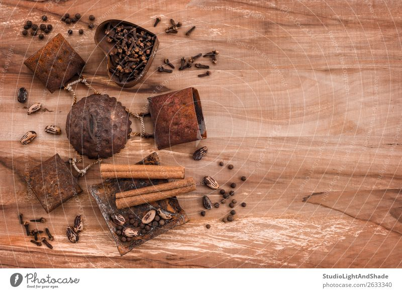 Spices in rusty metal plates on wooden background Old Dark Food Eating Wood Natural Style Time Copy Space Brown Design Nutrition Decoration Metal Retro Table