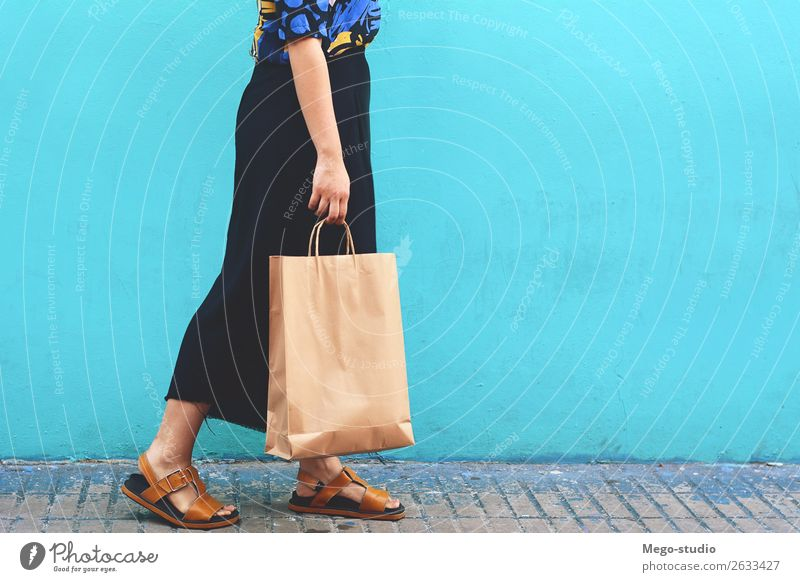Young woman walking with shopping bags Woman Human being Beautiful Hand Joy Street Lifestyle Adults Happy Style Fashion Modern Smiling Shopping Cool (slang)