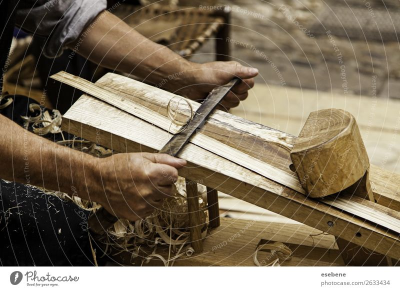 Removing wood chips in a traditional way Design Leisure and hobbies Work and employment Industry Craft (trade) Tool Hammer Human being Man Adults Hand Art Wood