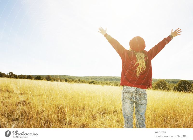 Back view of a young woman in nature in a sunny autumn day Happy Beautiful Leisure and hobbies Adventure Freedom Sun Child Human being Woman Adults
