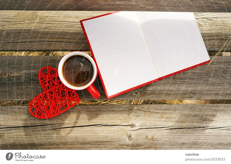Red mug with coffee in a wooden bench outdoors in the morning Breakfast Beverage Hot drink Coffee Tea Cup Mug Winter Book Reading Autumn Warmth Paper Wood Heart
