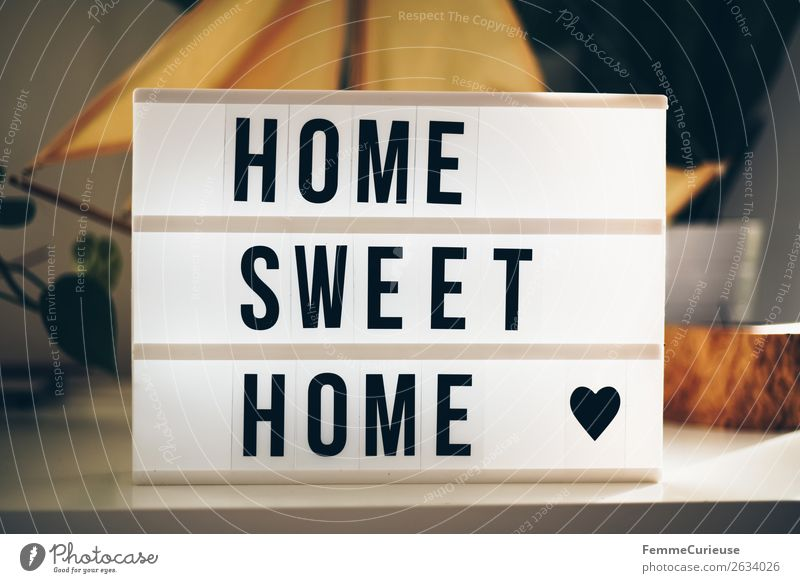 "Lightbox with the words ""home sweet home"" Characters Living or residing Figure of speech word group Heart sideboard Decoration Sunbeam Colour photo"
