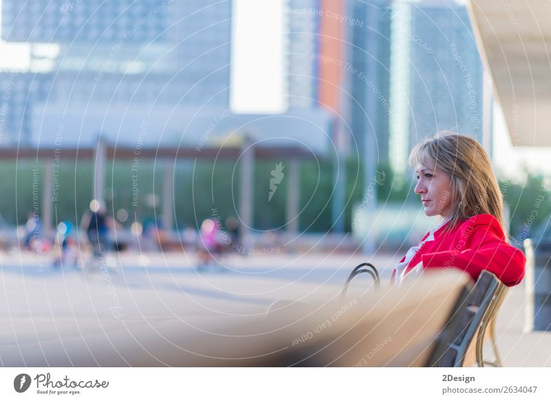 Blonde relaxed businesswoman sitting on a bench in the city Lifestyle Beautiful Calm Meditation Business Human being Feminine Woman Adults Park Shirt Skirt