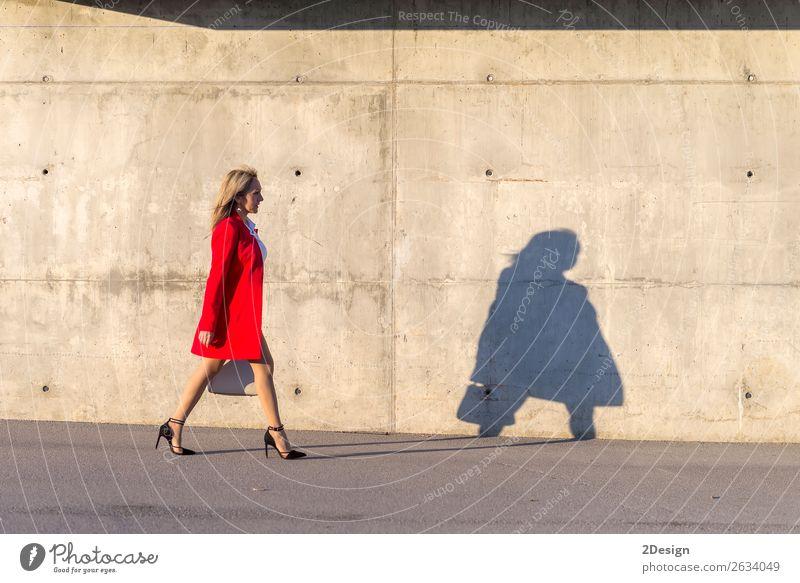 Blonde woman wearing red jacket walking on the street Lifestyle Beautiful Business Feminine Woman Adults Shirt Skirt Jacket Footwear High heels Red Black White