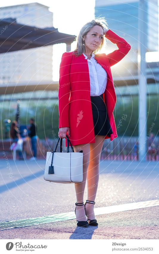 Elegant blonde woman standing in the street wearing red jacket Style Beautiful Human being Feminine Woman Adults Street Fashion Shirt Skirt Jacket Footwear