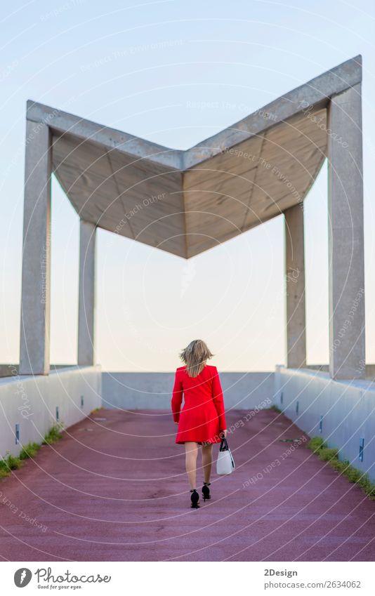 Rear image of a blonde woman wearing red jacket Lifestyle Business Feminine Woman Adults Shirt Skirt Jacket Footwear High heels Blonde Red Black White Behind